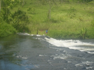 Local lads, diving the rapids